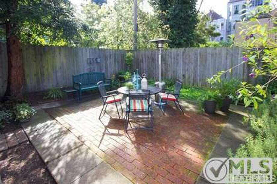 The brick patio is shared with only one other unit in this 2-unit building. Photo: MLS