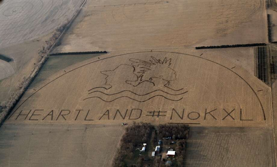 A huge crop art image protesting the proposed Keystone XL pipline covers an 80-acre cornfield outside of Neligh, Neb. Farmer Art Tanderup, who owns the land, drove the tractor that carved the image into dirt. It was based on a design created by artists John Quigley and Richard Vollaire. Photo: Courtesy Of Lou Dematteis, ASSOCIATED PRESS