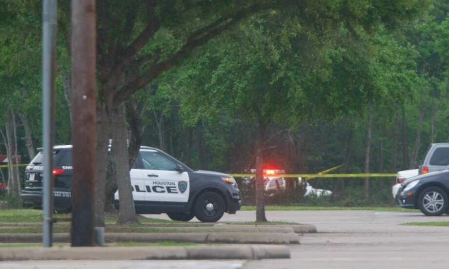 Police investigate the scene where a man was found dead in the 13000 block of Buffalo Speedway Photo: Cody Duty, Houston Chronicle