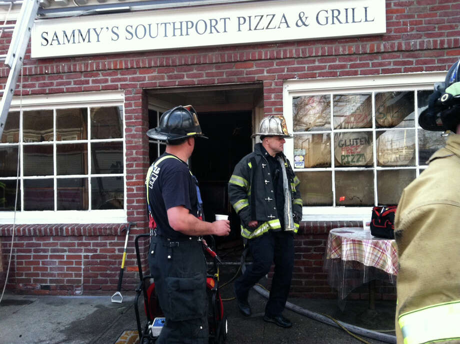 Firefighters at the scene of an early-morning fire that damaged Sammy's Southport Pizza and Grill at 295 Pequot Ave. Photo: Fairfield Fire Department / Fairfield Citizen