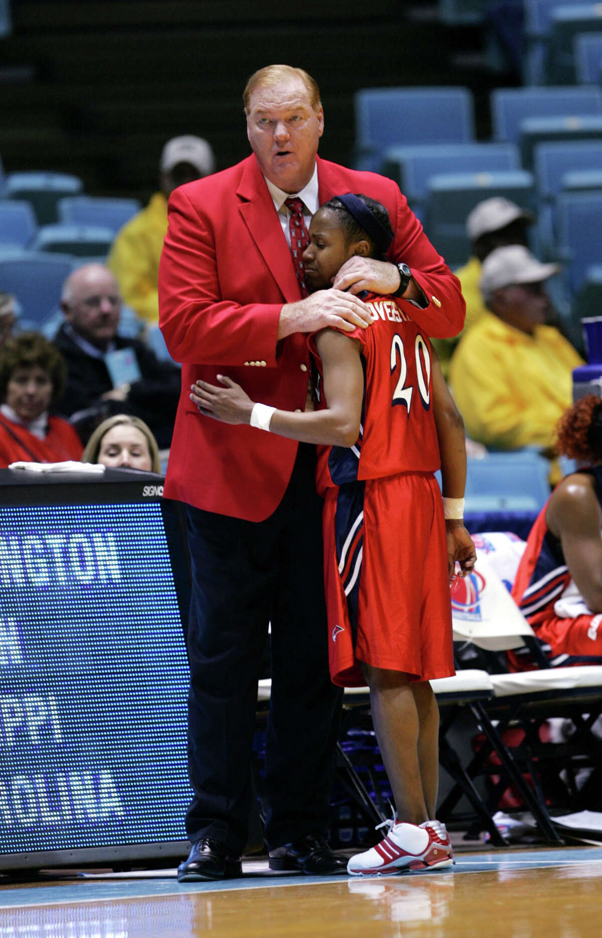 Houston coach Joe Curl consoles Joann Overstreet (20) near the end of their 63-43 loss to Boston College in the first round of the Women's NCAA tournament Sunday, March 20, 2005, in Chapel Hill, N.C. (AP Photo/Gerry Broome) HOUCHRON CAPTION (03/21/2005) SECSPTS: BIG HEART: UH coach Joe Curl consoles Joann Overstreet.