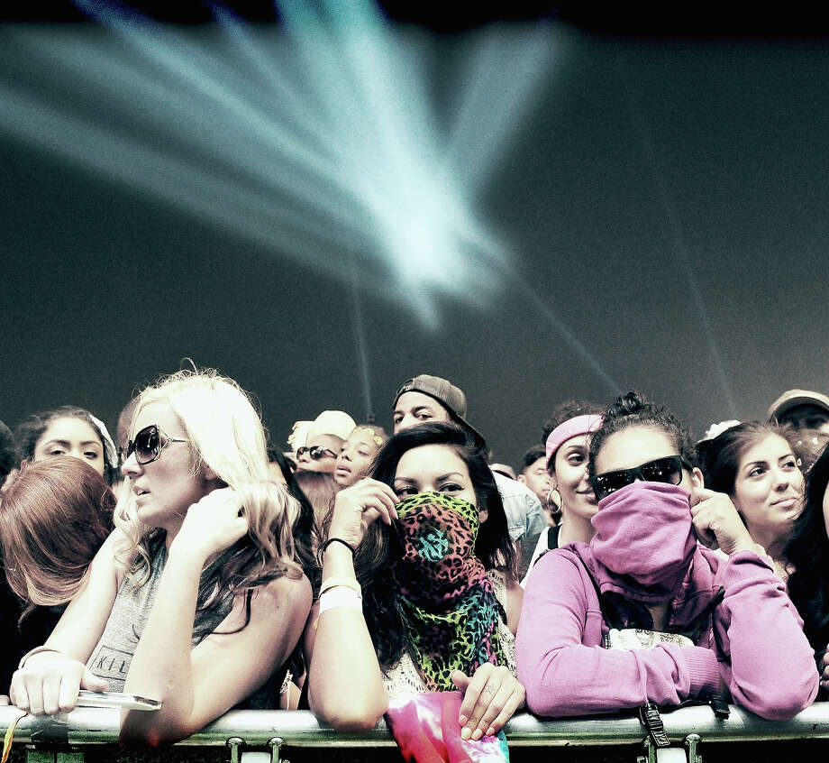Music fans attend day 2 of the 2014 Coachella Valley Music & Arts Festival. Photo: Frazer Harrison, Getty Images / 2014 Getty Images