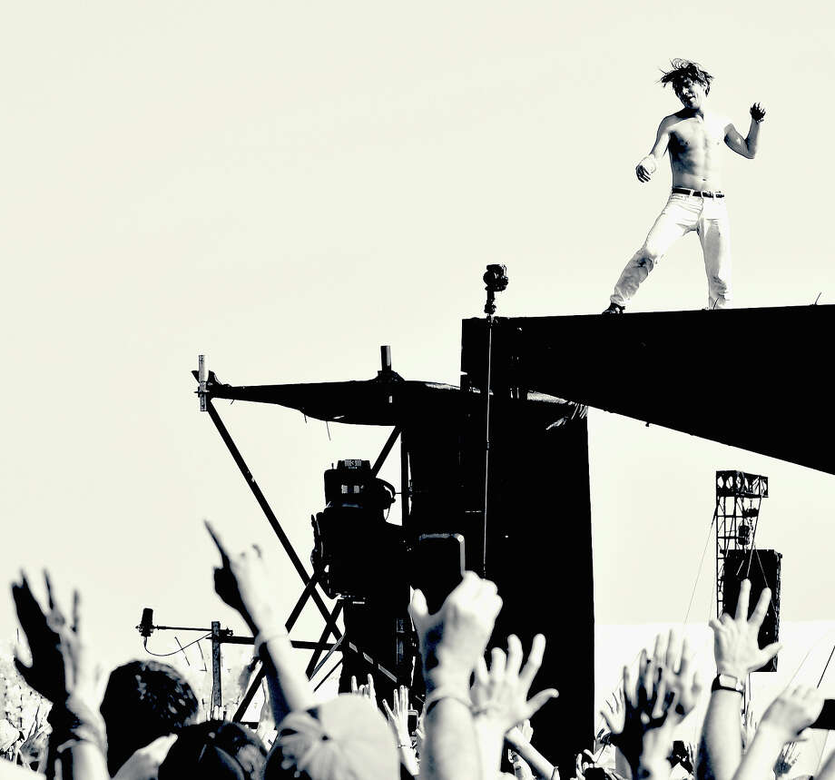 Singer Matt Shultz of Cage the Elephant performs onstage. Photo: Kevin Winter, Getty Images / 2014 Getty Images