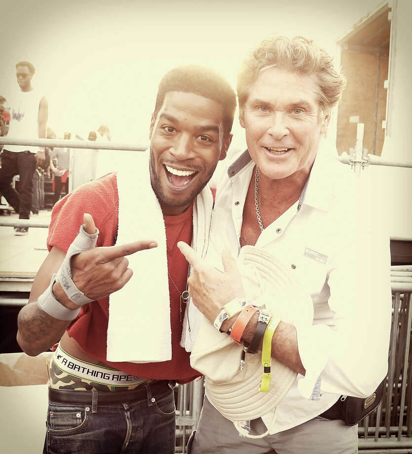 Rapper Kid Cudi (L) and David Hasselhoff pose backstage during day 2 of the 2014 Coachella Valley Music & Arts Festival. Photo: Kevin Winter, Getty Images / 2014 Getty Images