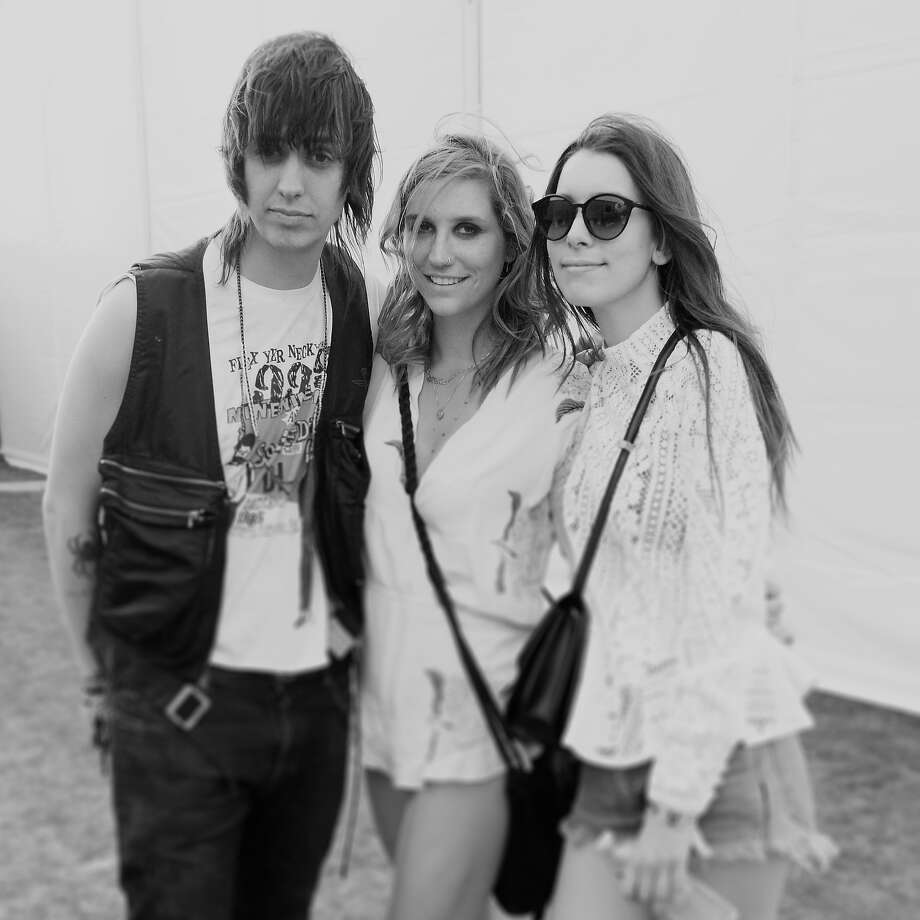 (L-R) Musicians Julian Casablancas, Kesha and Danielle Haim pose backstage during day 2 of the 2014 Coachella Valley Music & Arts Festival. Photo: Jason Kempin, Getty Images / 2014 Getty Images