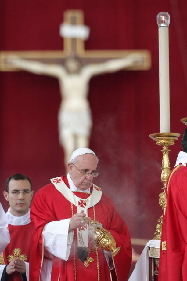 Pope Francis blesses the alter with incense during the Palm Sunday Mass at St. Peter's Square on April 13, 2014 in Vatican City, Vatican. On Palm Sunday Christians celebrate Jesus' arrival into Jerusalem, where he was put to death. It is the sixth Sunday of Lent and marks the official beginning of Holy Week during which Christians observe the death of Christ before celebrations begin on Easter Sunday. Photo: Franco Origlia, Getty Images / 2014 Franco Origlia