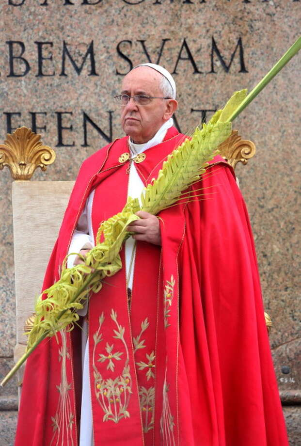 Pope Francis carries a palm during the Palm Sunday Mass at St. Peter's Square on April 13, 2014 in Vatican City, Vatican. On Palm Sunday Christians celebrate Jesus' arrival into Jerusalem, where he was put to death. It is the sixth Sunday of Lent and marks the official beginning of Holy Week during which Christians observe the death of Christ before celebrations begin on Easter Sunday. Photo: Franco Origlia, Getty Images / 2014 Franco Origlia