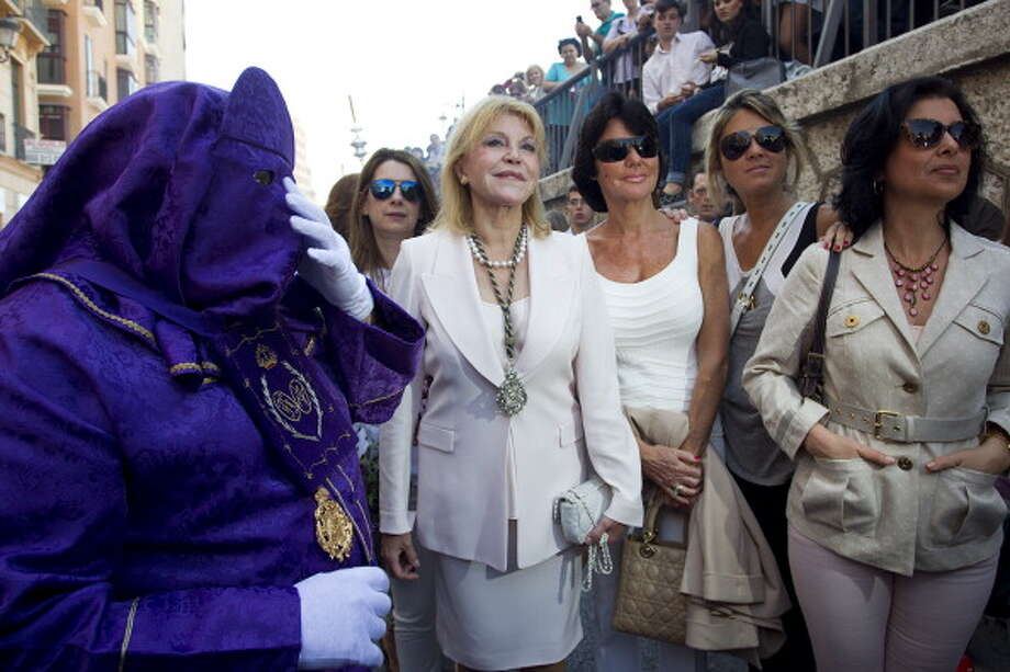 Baroness Carmen Thyssen-Bornemisza (C) attends the Pollinica procession during Holy Week celebrations on April 13, 2014 in Malaga, Spain. Photo: Daniel Perez Garcia-Santos, Getty Images / 2014 Daniel Perez Garcia-Santos