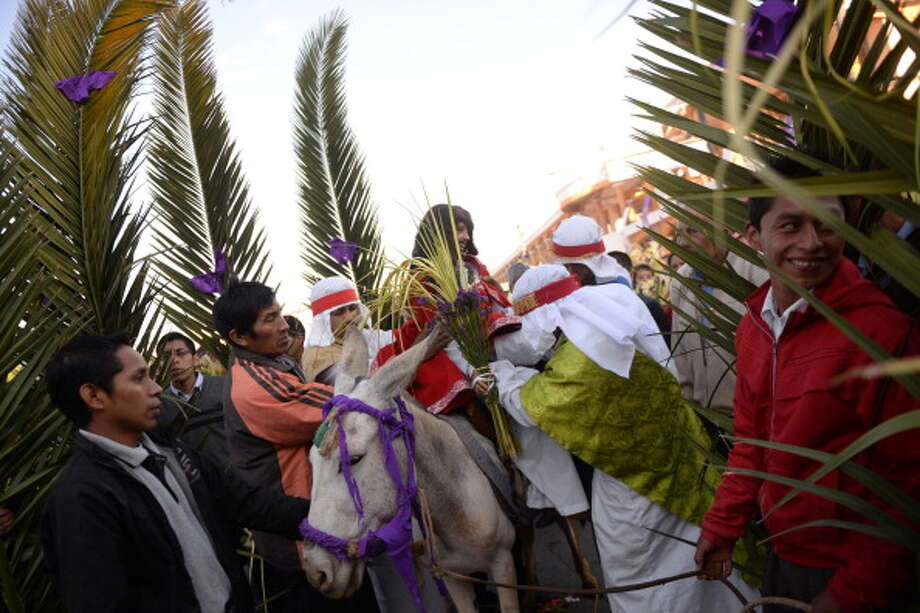Catholic faithfuls prepare to start the Palm Sunday procession on April 13, 2013 in San Pedro Sacatepequez, 30 km west of Guatemala City. Palm Sunday marks the start of the most solemn week is the Roman Catholic calendar, marking the triumphant return of Christ to Jerusalem the week before his death, when a cheering crowd greeted him waving palm leaves. Photo: JOHAN ORDONEZ, AFP/Getty Images / 2014 AFP