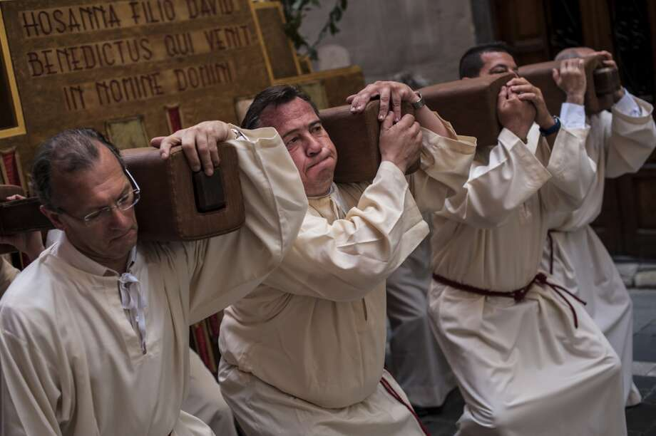 Penitents take part in the procession during Palm Sunday, prior to Spain Holy Week, in Pamplona, northern Spain, Sunday April 13, 2014.  Spanish devoted Catholics take part in a lot of religious ceremonies during Holy Week. Photo: Alvaro Barrientos, Associated Press