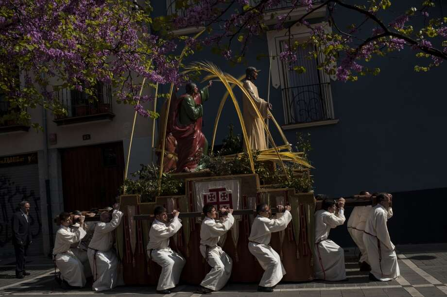 Penitents take part in a procession during Palm Sunday, prior to Spain Holy Week, in Pamplona, northern Spain, Sunday April 13, 2014.  Spain's devoted Catholics take part in a lot of religious ceremonies during Holy Week. Photo: Alvaro Barrientos, Associated Press
