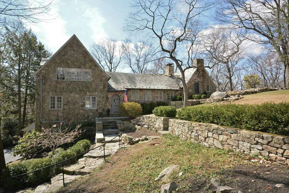Designed by architect Frazier Peters in 1939, the stone house at 9 East Trail in Darien offers a cozy and private retreat. It is on the market for $1,725,000. Photo: Contributed Photo, Contributed / Darien News