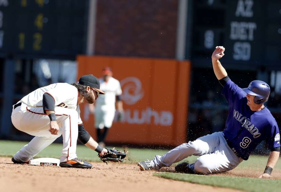 Brandon Crawford tagged out D.J. LeMahieu to end the tenth inning with a double play. The San Francisco Giants defeated the Colorado Rockies 5-4 in ten innings Sunday April 13, 2014 at AT&T park. Photo: The Chronicle