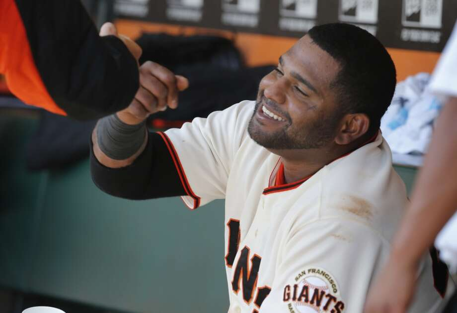 Pablo Sandoval was congratulated in the dugout after his home run. The San Francisco Giants defeated the Colorado Rockies 5-4 in ten innings Sunday April 13, 2014 at AT&T park. Photo: The Chronicle