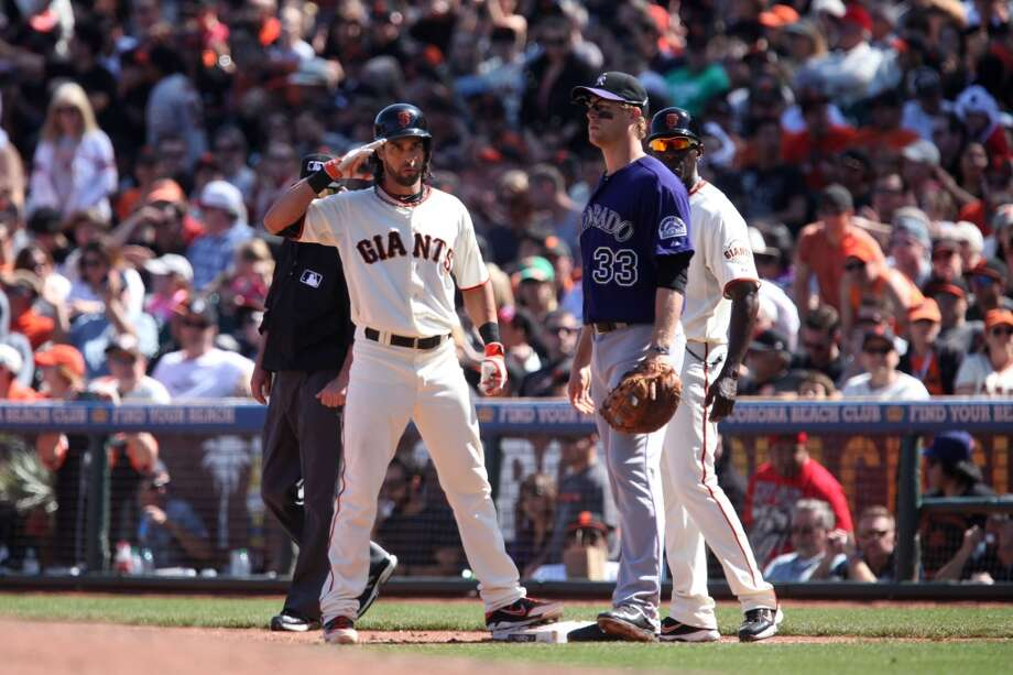 Angel Pagan from the San Francisco Giants salutes the crowd when he gets on first base during ninth inning of the game with the Colorado Rockies in San Francisco, Calif. on April 13, 2014. Photo: The Chronicle