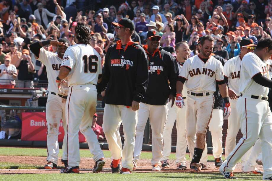 San Francisco Giants players celebrate following a 5-4 win with the Colorado Rockies in San Francisco, Calif. on April 13, 2014. Photo: The Chronicle