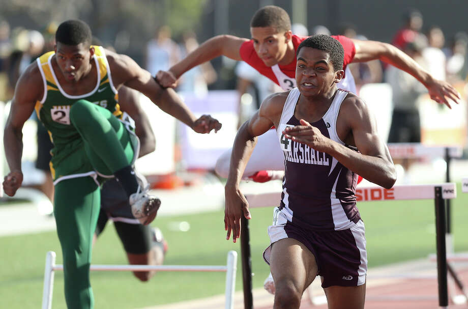 Carl Bibbs takes the 110 hurdles for Marshall during the District 27-5A track meet at Gustafson Stadium on April 10, 2014. Photo: TOM REEL
