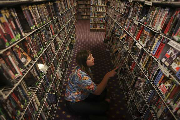 Maya Falkenberg looks for a film to rent on the second floor of LeVideo in San Francisco on April 12th 2014.