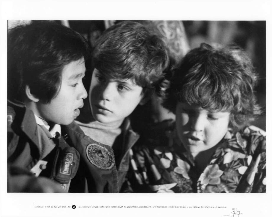 "Actors (left to right) Jonathan Ke Quan, Sean Astin and Jeff Cohen star in a scene from ""The Goonies.""  Photo: Michael Ochs Archives, Getty Images / 2011 Getty Images"