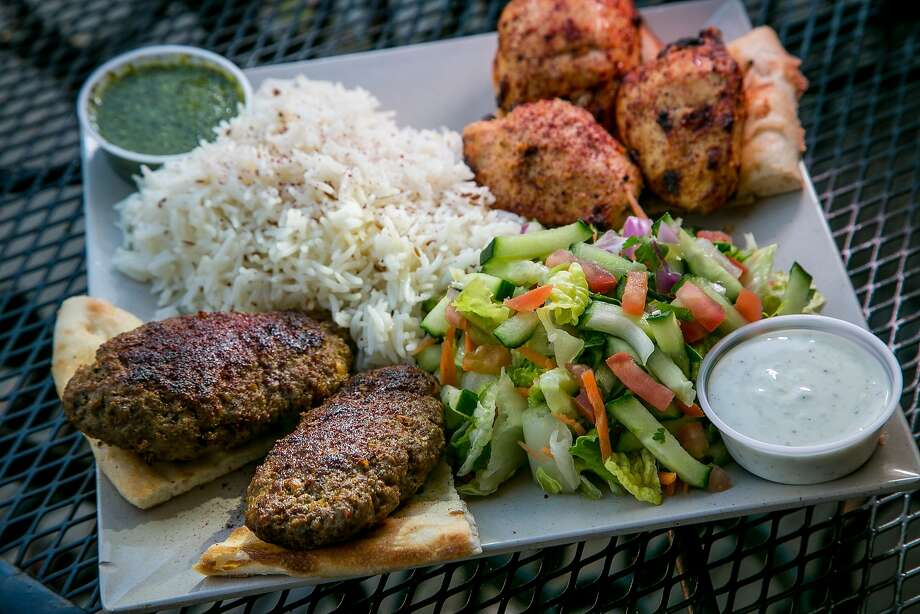 The combo kabob plate ($13) at Q's Halal Chicken includes chicken kabobs as well as ground beef skewers, rice, salad and naan. Photo: John Storey, Special To The Chronicle