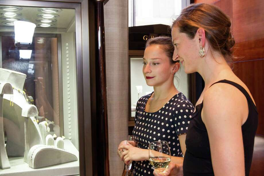 Smuin Ballet dancers Terez Dean and Jane Rehm admire some of the jewelry at Graff Diamonds' cocktail reception honoring Smuin Ballet's 20th Anniversary benefactors and sponsors, held Wednesday, April 9, 2014 at Graff Diamonds in San Francisco. Photo: Laura Morton For Drew Altizer, Drew Altizer Photography / Drew Altizer Photography