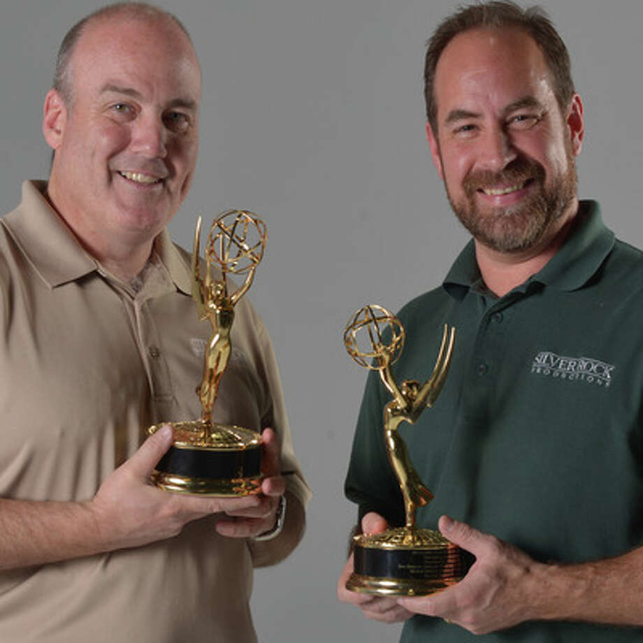 Silver Rock Productions owners Mike Huffine and Brian Falcon hold their recently won Emmy Awards.