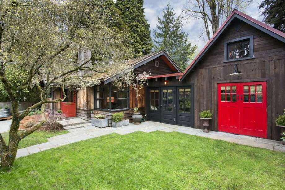 "We'll start with the oldest home, 1426 37th Ave. E., a ""summer cottage"" built in 1918. The 730-square-foot house has two bedrooms, one bathroom, a studio, a shake roof, a patio, an herb garden and a tree house on a 3,960-square-foot lot. It's listed for $650,000. Photo: Courtesy Mary P. Snyder/Windermere Real Estate"