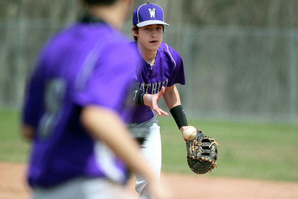 Westhill High School first baseman Matt Gorey makes a toss to a teammate for an out during FCIAC baseball action in Stamford, Conn on Monday, April 14, 2014. Westhill, led by timely hitting, won the well played game, 5-4.