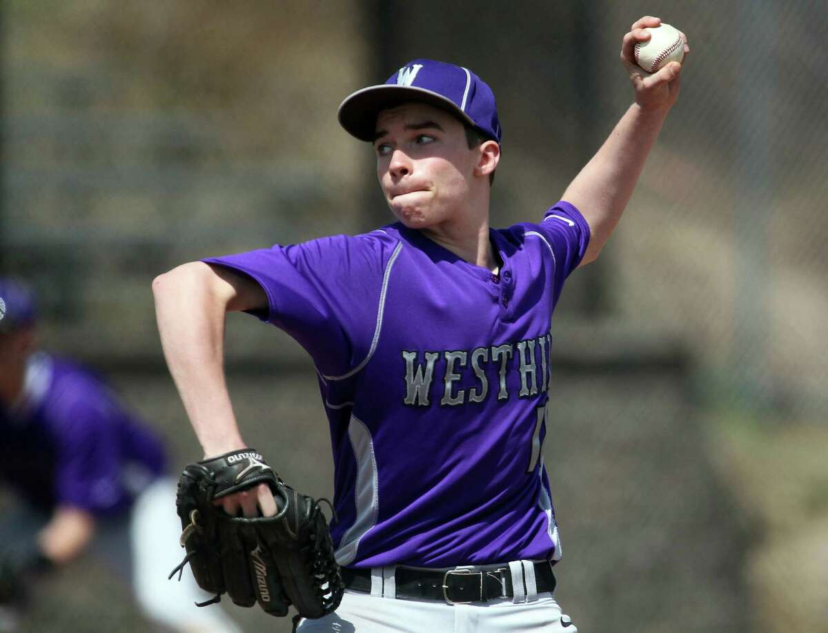 Westhill starting pitcher Dan Rotkewicz (#18) won a decision against Ridgefield High School on Monday, April 14, 2014 in Stamford, Conn. Westhill held on for closely fought 5-4 win.