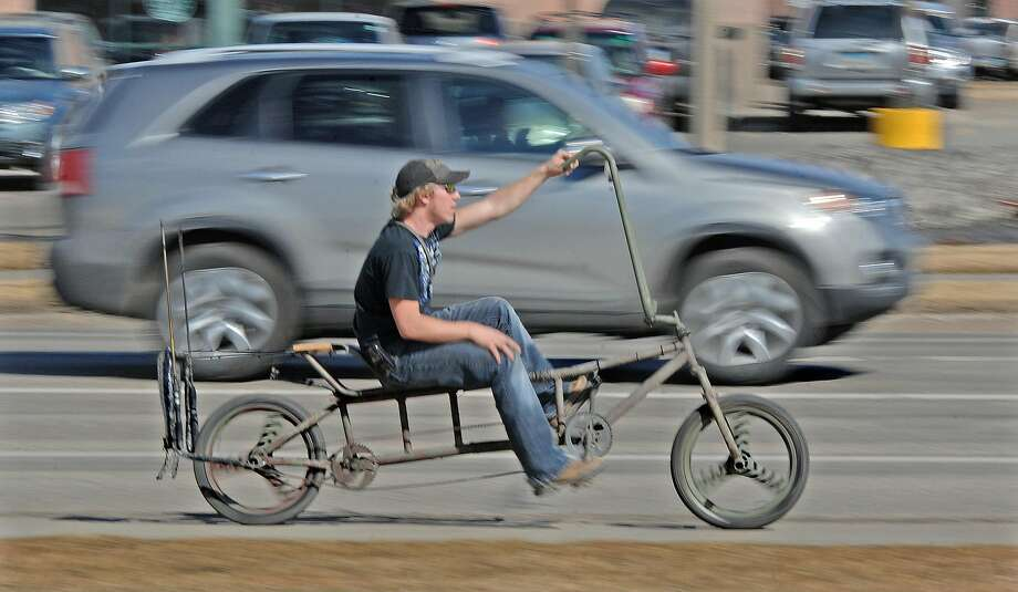 Great for long rides:It took Craig Trehus of Bismark, N.D., four months to build this chopped bike out of three   bicycles and the ladder off a boat. Photo: Tom Stromme, Associated Press