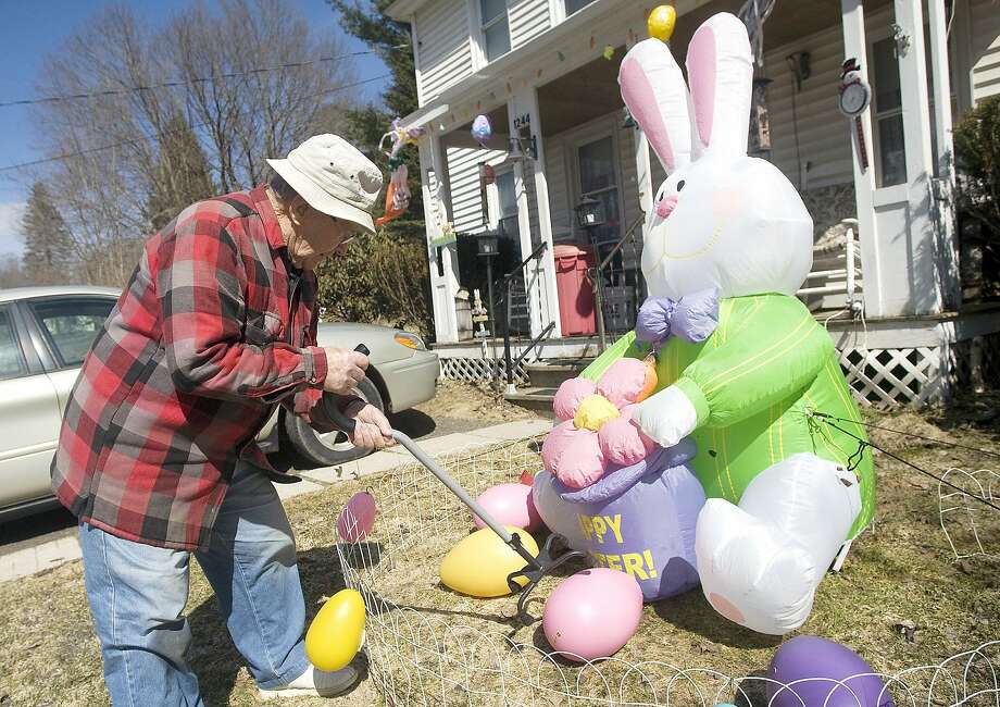 Get on my lawn!Paul Levine, 87, uses his cane to arrange eggs for a kid-friendly 
