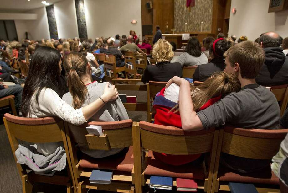 People gather to mourn the victims of the shootings at St. Thomas the Apostle Episcopal Church in Overland Park, Kan. Three people were fatally shot near two Jewish facilities in the Kansas City suburb. Photo: Tammy Ljungblad, McClatchy-Tribune News Service