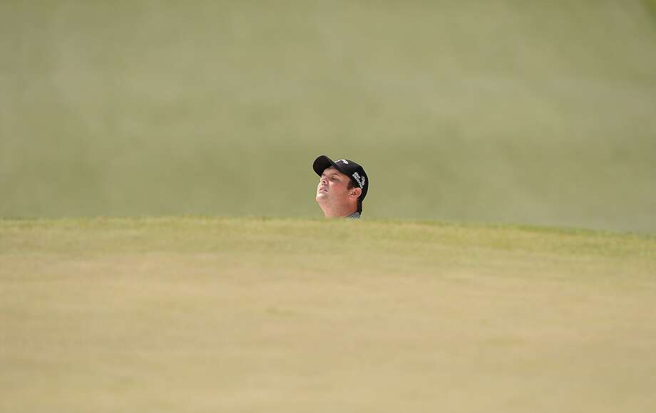Am I a head yet? Patrick Reed plays out of a bunker during the Masters in Augusta, Ga. Photo: Emmanuel Dunand, AFP/Getty Images