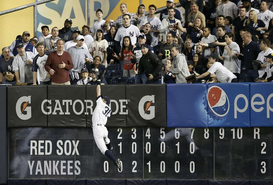 Look at that old man jump!Veteran Yankees outfielder Ichiro Suzuki (age 40) robs Boston's David Ortiz of 