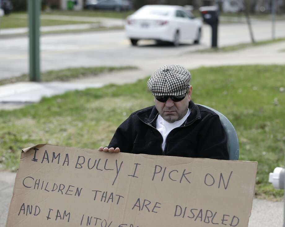 The worst person in South Euclid, Ohio: Edmond Aviv sits on a street corner in South Euclid, Ohio, holding 