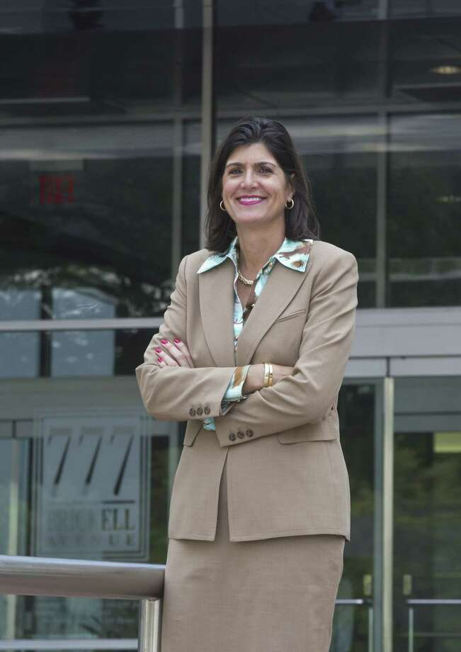 Mary Jo Eaton, executive managing director of CBRE, in front of the 777 Brickell Building, one of the properties the firm manages and where its Miami office is located. Eaton has taken big risks to help CBRE expand in Florida, most recently opening a Tallahassee office. (CW Griffin/Miami Herald/MCT) ORG XMIT: 1151300 Photo: CW Griffin / Miami Herald