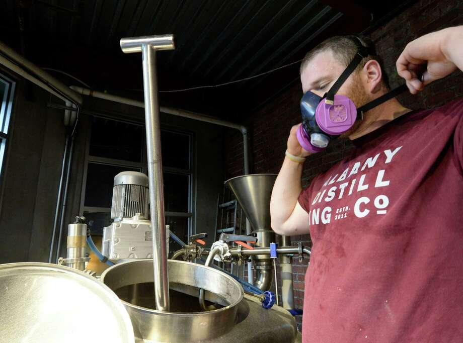 Sam Pagano plies his trade as a brewmaster Tuesday morning, April 8, 2014, at the C.H. Evans Brewing Co in Albany, N.Y.   (Skip Dickstein / Times Union) Photo: Skip Dickstein / 00026381A