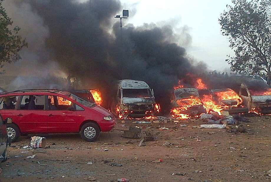 Vehicles burn after a huge explosion at the Nyanya bus station in Nigeria's capital, Abuja. Photo: Str, AFP/Getty Images