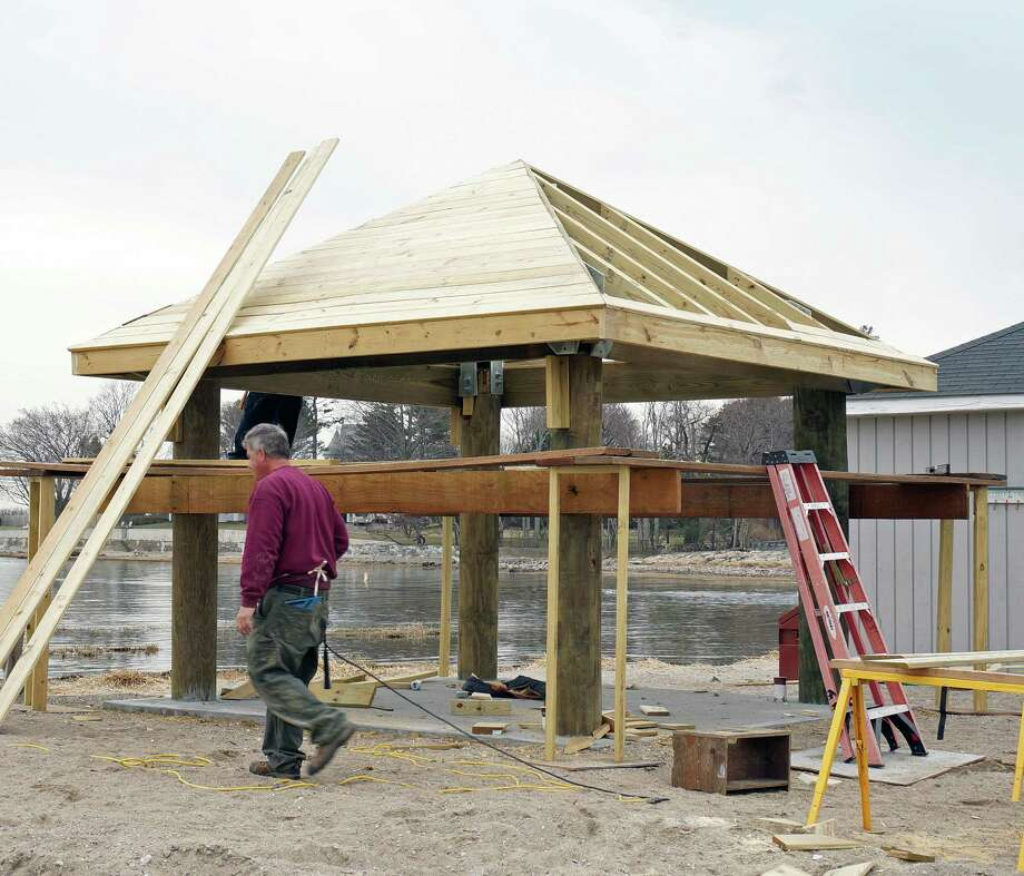 The Public Works Department continues working to get town beaches ready for the summer season. Here, a new lifeguard shed is going up at Southport Beach. Photo: Genevieve Reilly / Fairfield Citizen