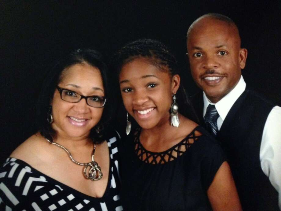 Deja Hall (center) has the full support of her family: Mom Teresa and dad  Dean. Photo: Courtesy