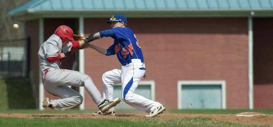Devin McGrath, #5, Greenwich, and Danbury's Eric Cerno, #33, collide as McGrath tries to avoid the throw to second during a boys FCIAC baseball game between Greenwich High School and Danbury High School on Monday, April 14, 2014, in Danbury, Conn. Photo: H John Voorhees III / The News-Times Freelance