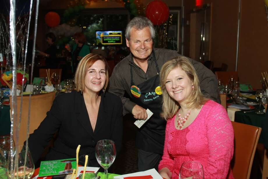 Leslie Wilson, celebrity server John DeMers, and Julie Burgman Photo: Gary Fountain, For The Chronicle