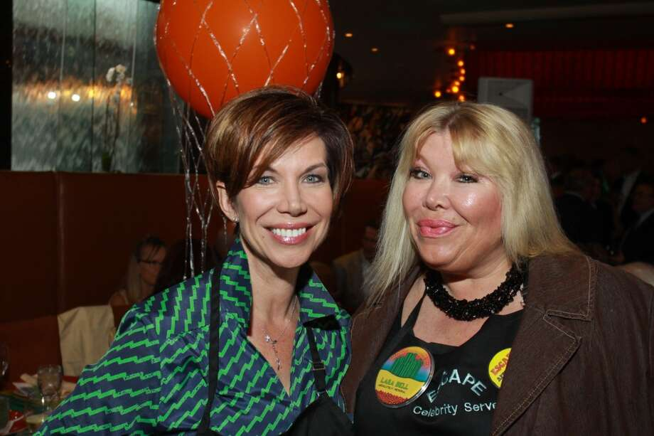 Celebrity servers Roseann Rogers, left, and Lara Bell Photo: Gary Fountain, For The Chronicle