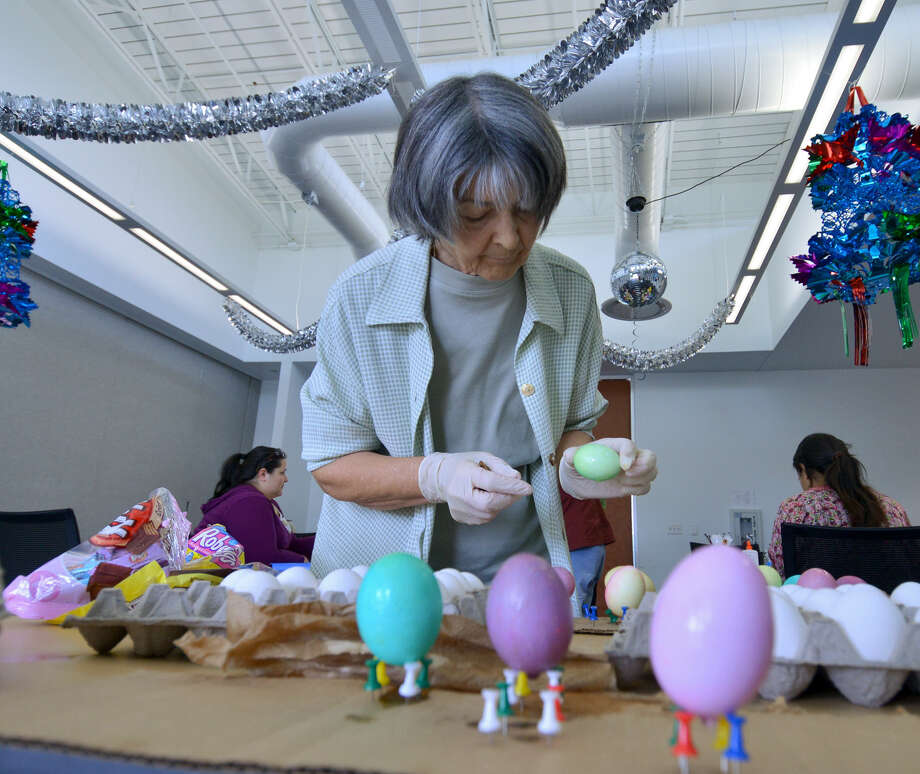 Elisabeta Popescu prepares to dry one of her eggs during a creative egg decorating class at the Parman Stone Oak Library. Photo: Courtesy Photos