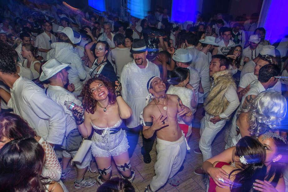 Partygoers dancing on the Bently Reserve's dancefloor. Photo: Misha Kutuzov, ©MKGraph / ©MKGraph