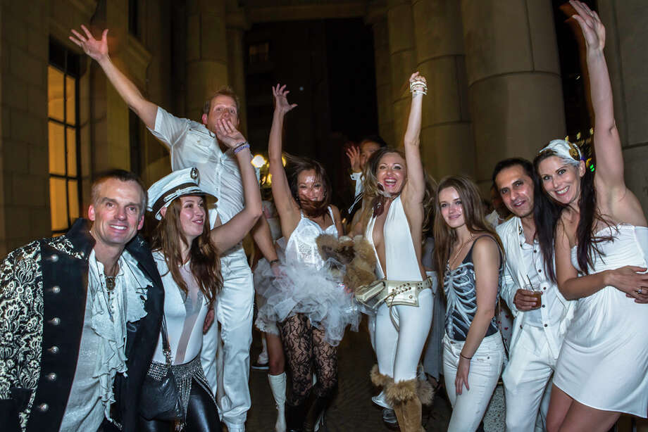 White-clad partygoers jump for a camera shot Photo: Misha Kutuzov, ©MKGraph / ©MKGraph