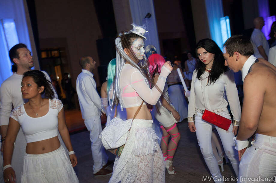 Guests show off their creative, predominantly white costumes Photo: Mark Rahmani
