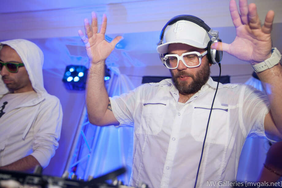 The DJ moves to the music at the White Party Photo: Mark Rahmani