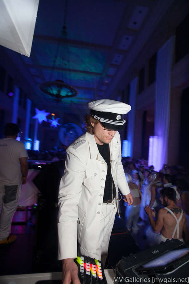A man in a white sailor suit Photo: Mark Rahmani