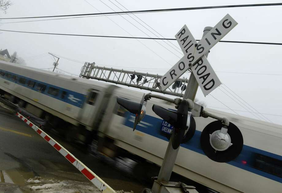 A Metro-North train bound for Danbury crosses Greenwood Avenue in Bethel, Conn.in this file photo. Photo: Tyler Sizemore / The News-Times